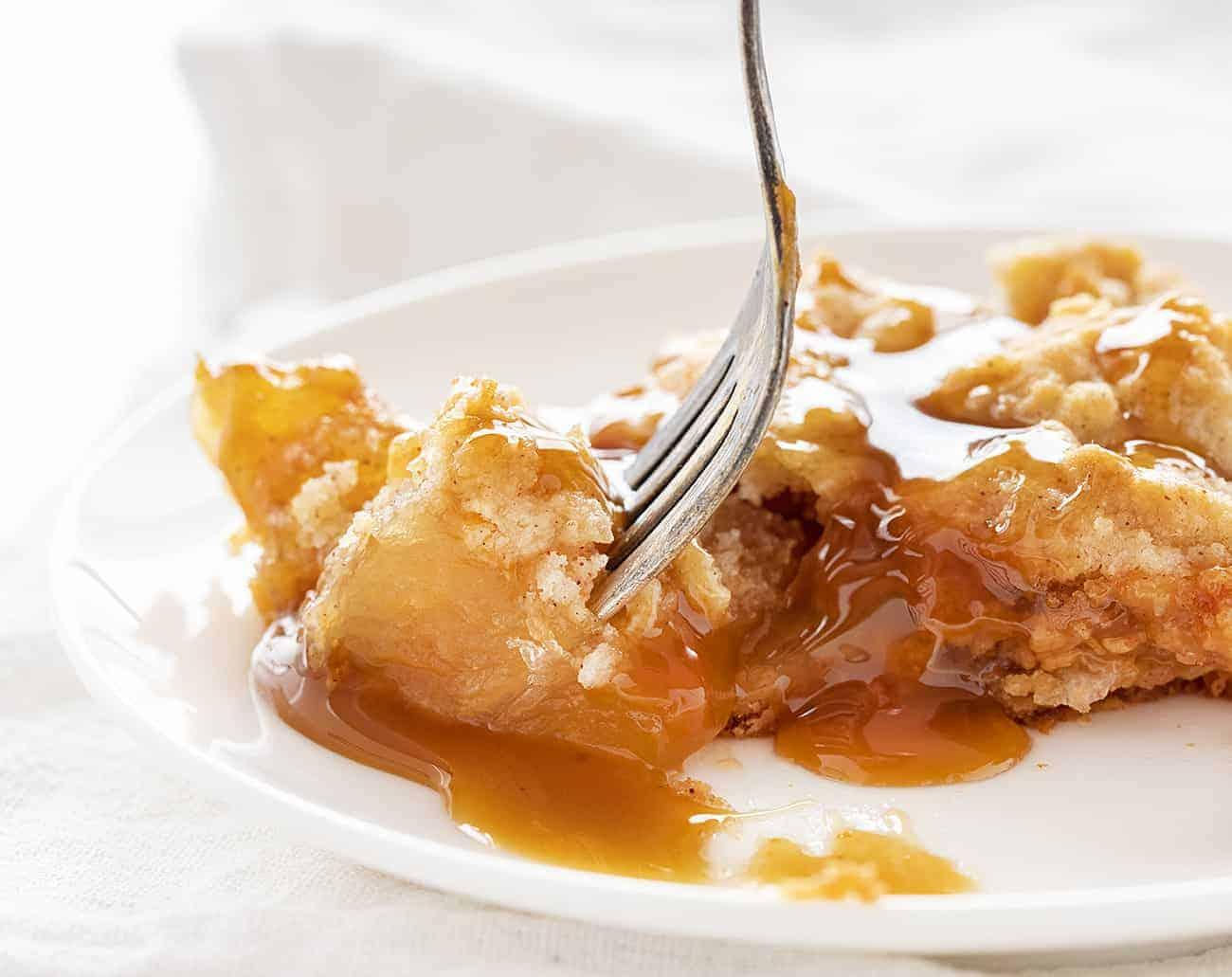 Taking a bite of Caramel Apple Dump Cake