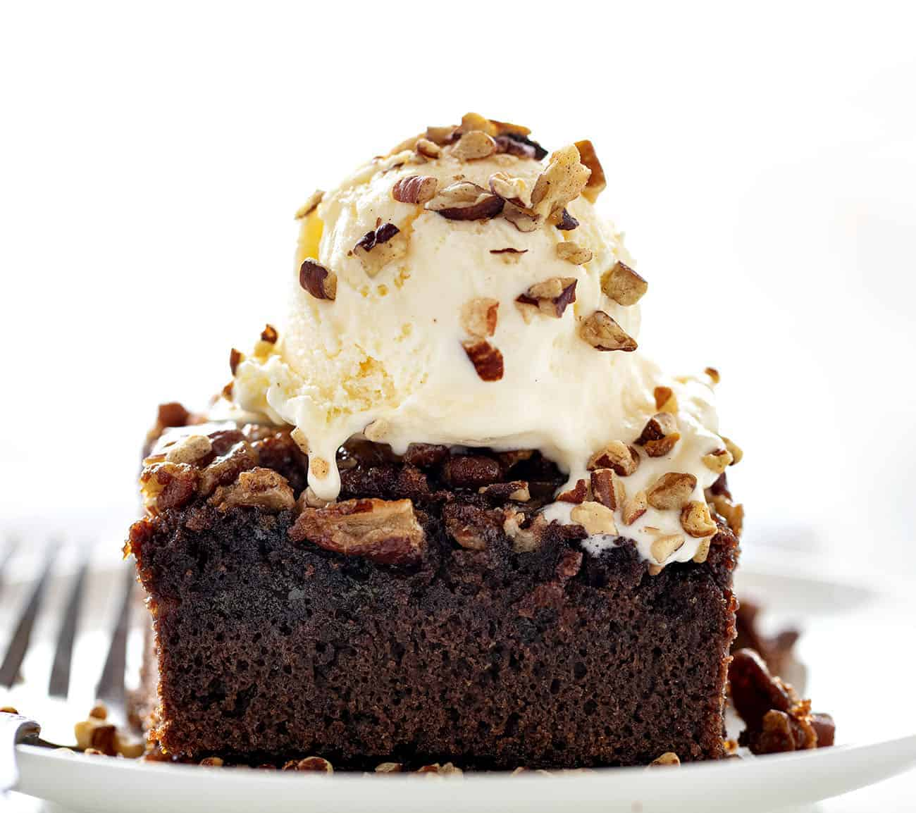 PIece of Ooey Gooey Pecan Brownies with Ice Cream on Top