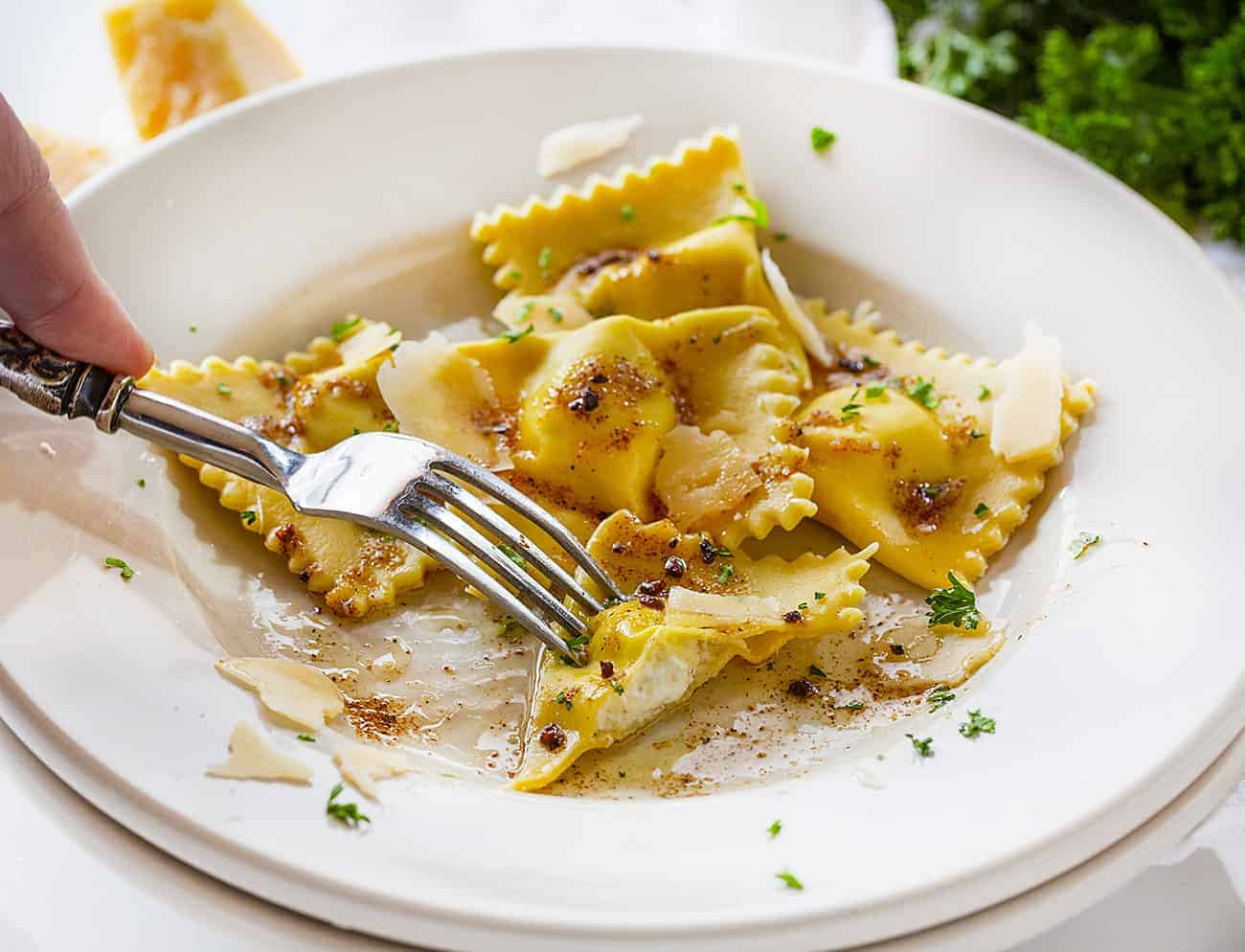Cut into Piece of Homemade Five Cheese Ravioli Showing the Cheese Filling