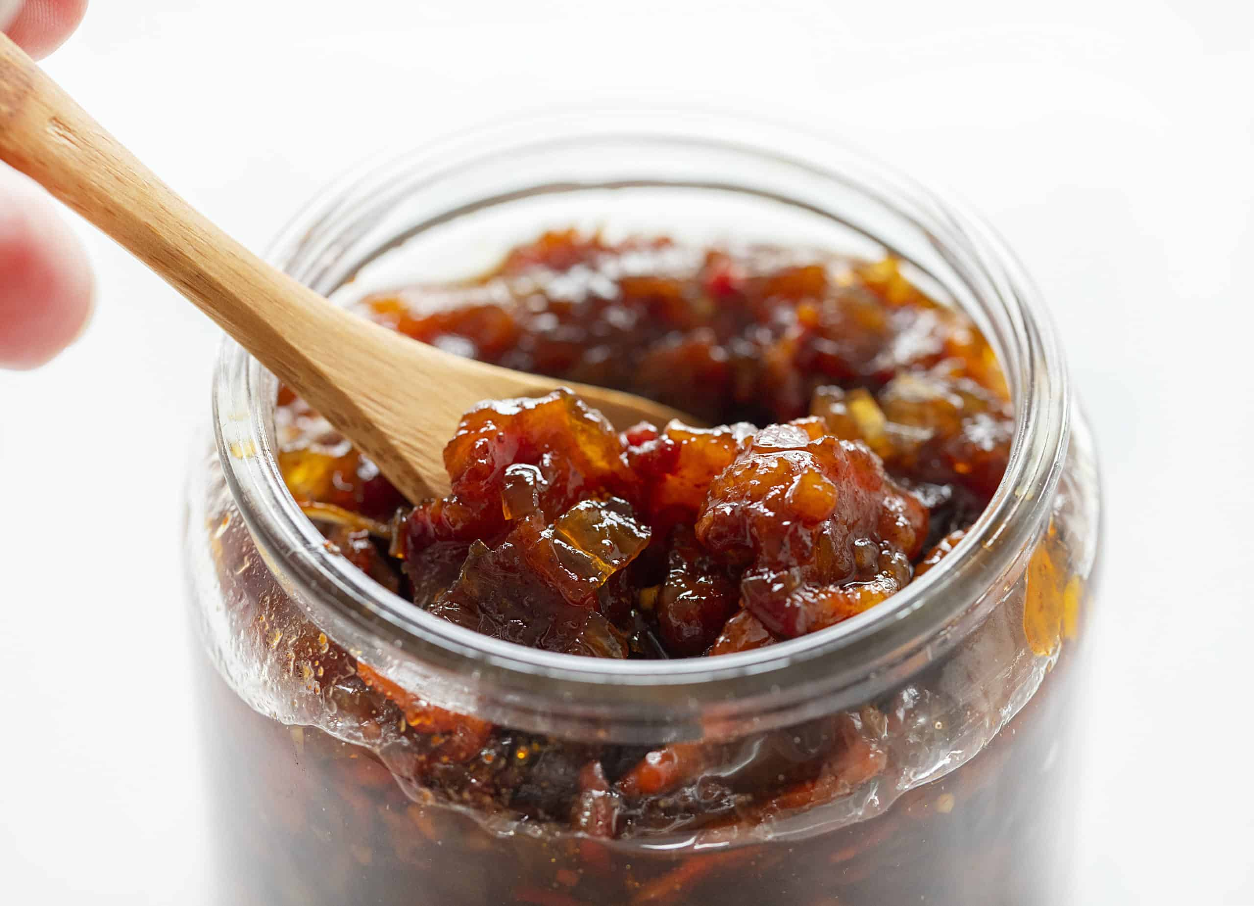 Onion Bacon Jam in a Jar with a Spoon