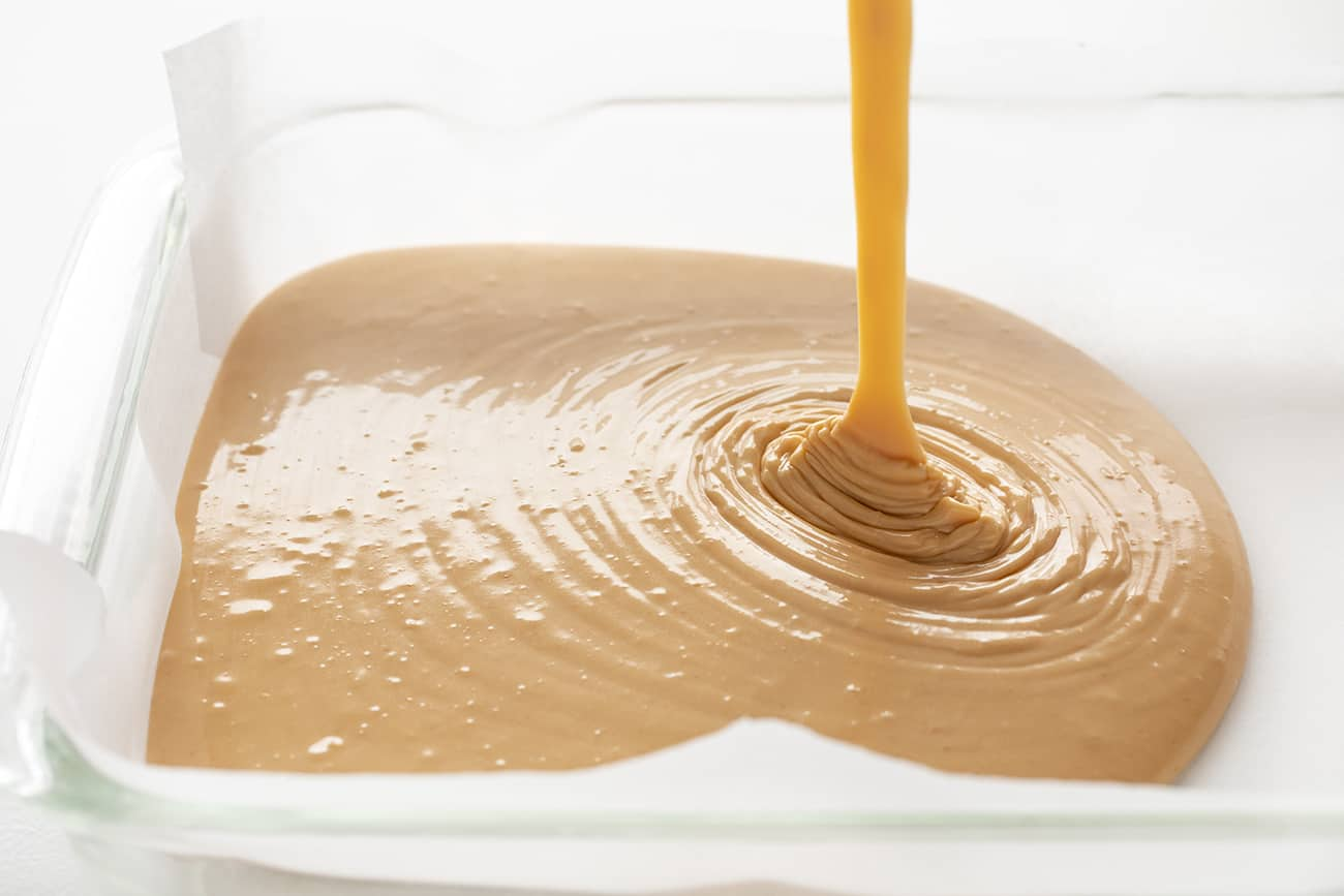Creamy Peanut Fudge Being Poured Into Pan