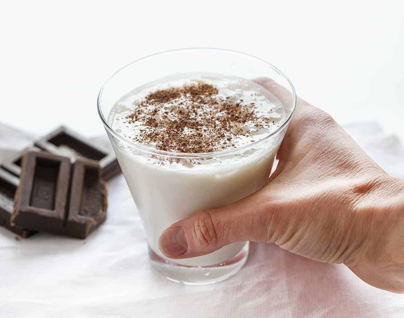 Hand picking up White Chocolate Martini