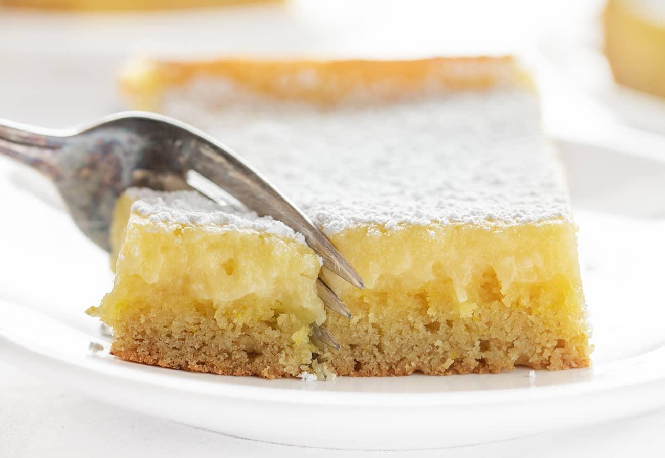 Fork Cutting Lemon Ooey Gooey Cake