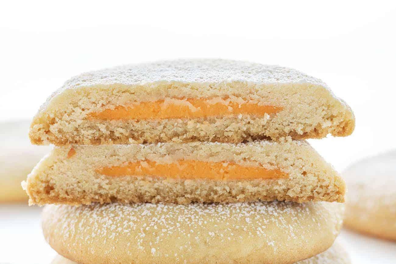 Orange Creamsicle Stuffed Sugar Cookies Cut Open to Reveal Inside