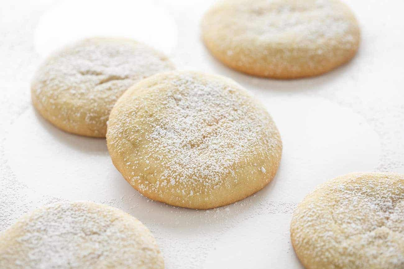 Orange Creamsicle Stuffed Sugar Cookies Dusted With Confectioners Sugar