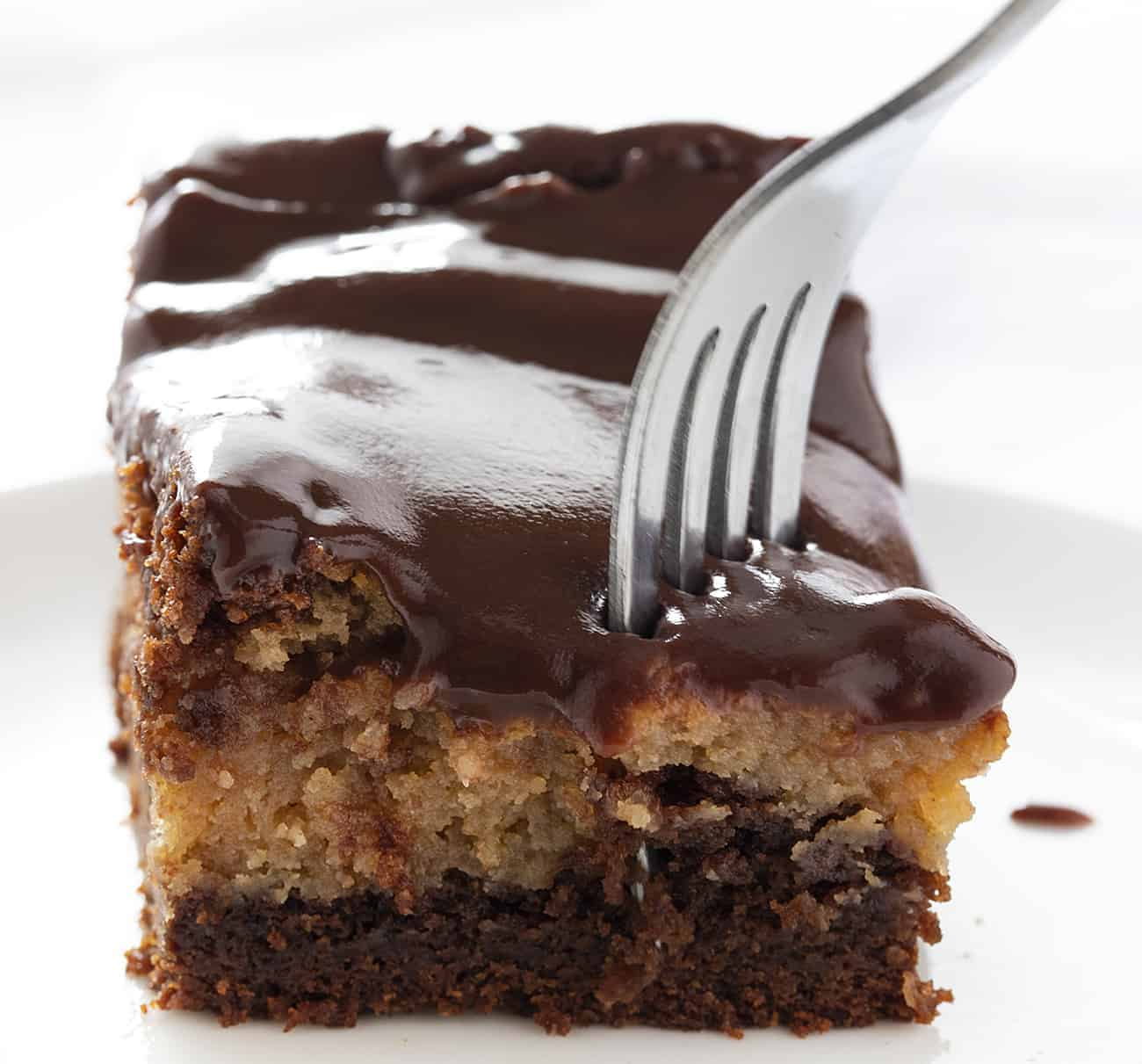 Fork Taking Piece from Chocolate Peanut Butter Ooey Gooey Cake
