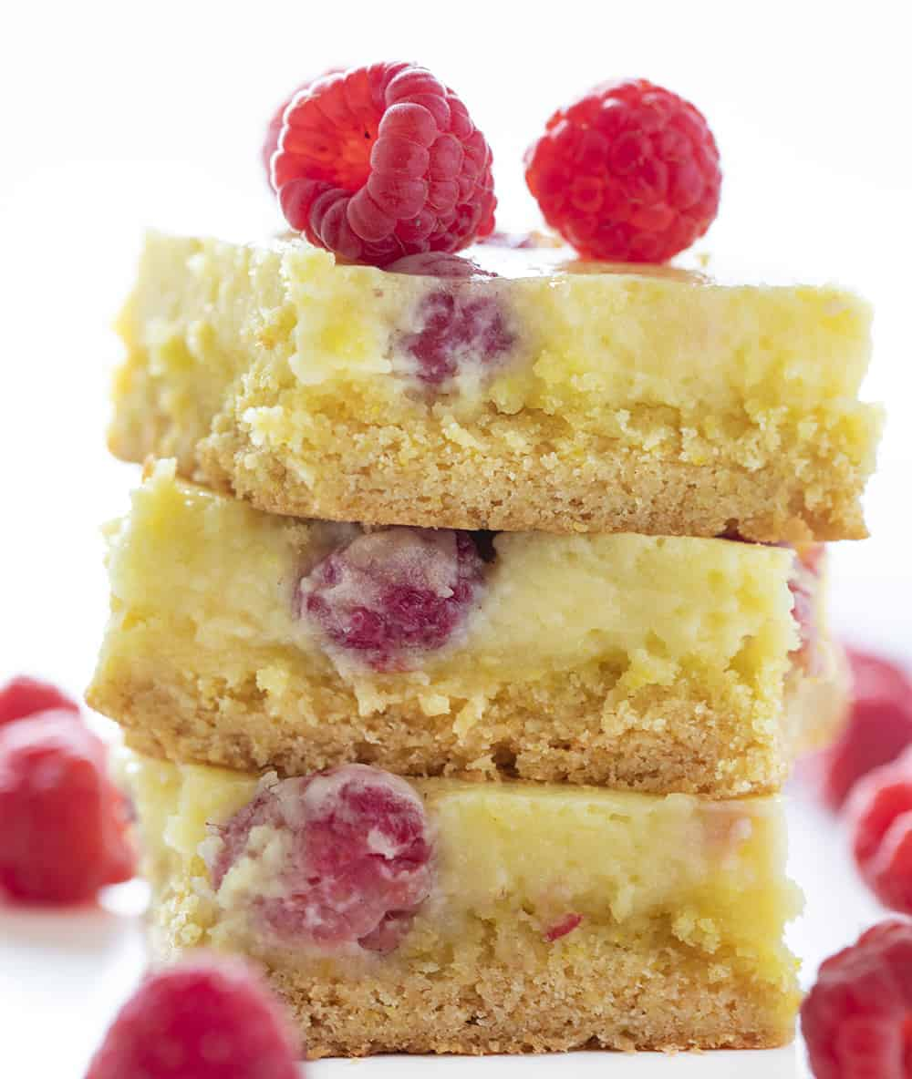 Raspberry Lemon Ooey Gooey Cake Stacked with Fresh Raspberries