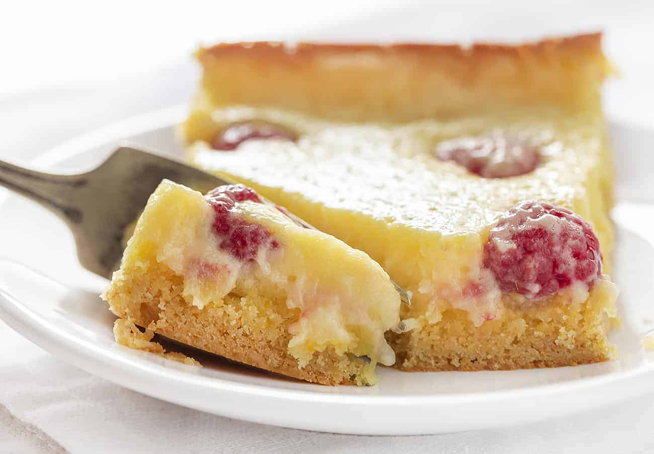 Fork Cutting Into Raspberry Lemon Ooey Gooey Cake