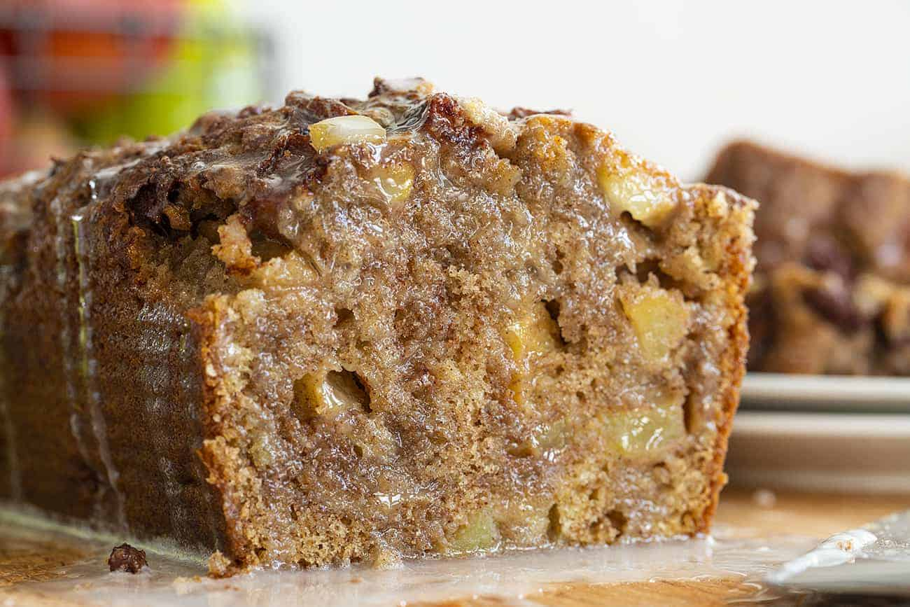 Apple Fritter Bread with Chunks of Apples Showing and Glaze Seeping over Bread