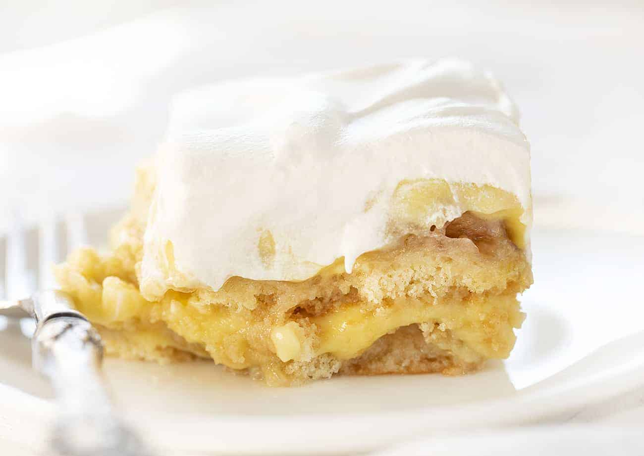 Piece of The Ultimate Banana Pudding on a White Plate with Fork