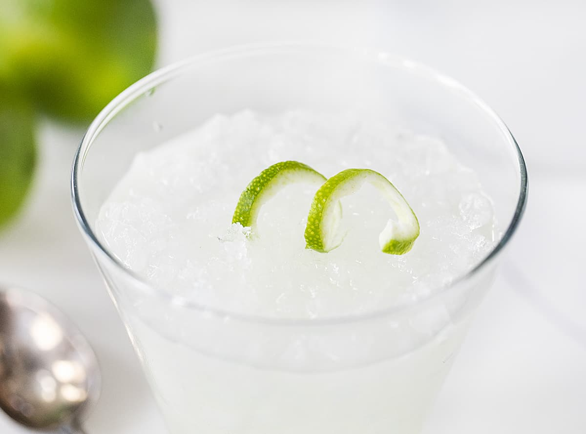 A Prepared Vodka Gimlet with Lime Garnish in Glass of Ice