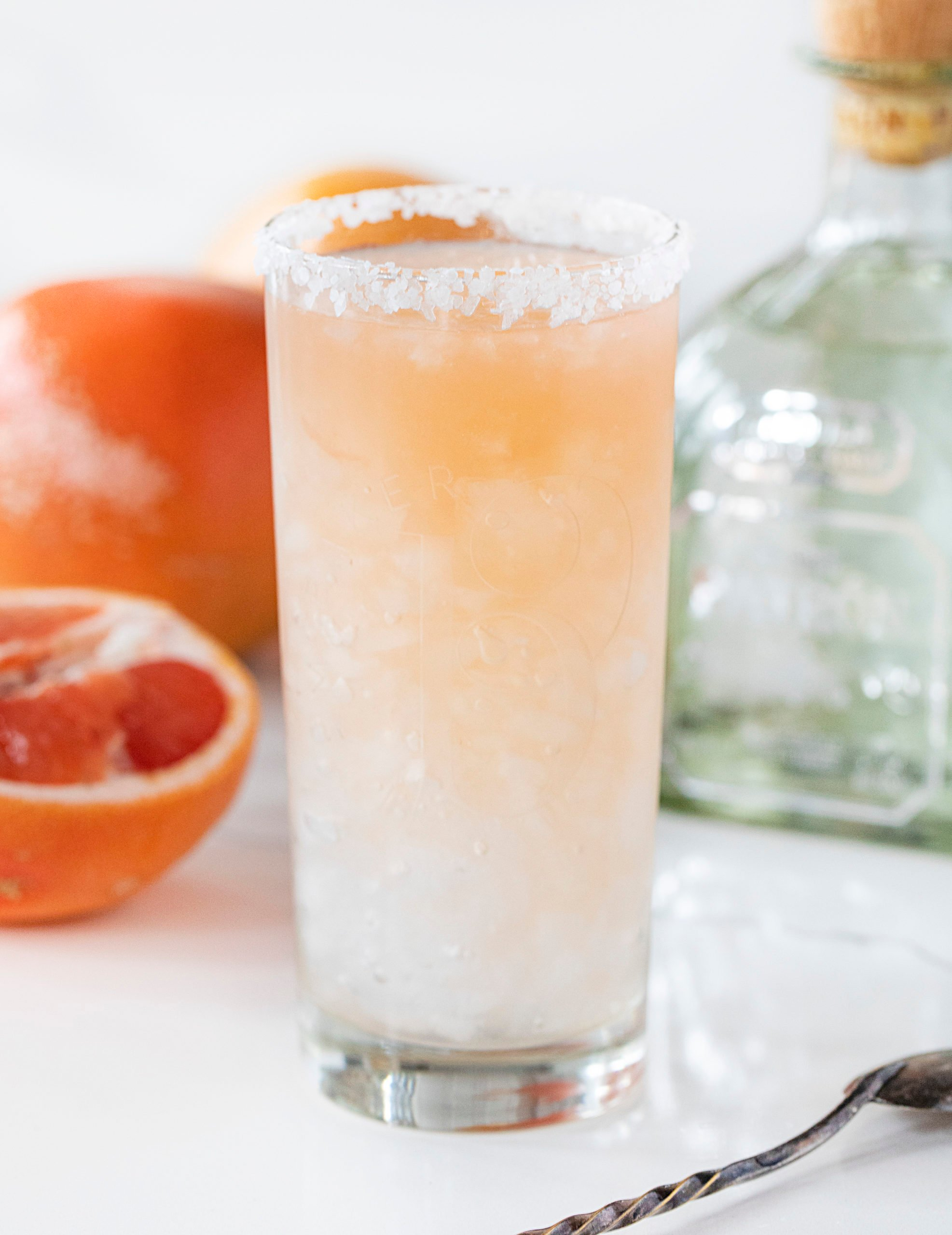 Glass of Paloma with Patron and Grapefruit in Background
