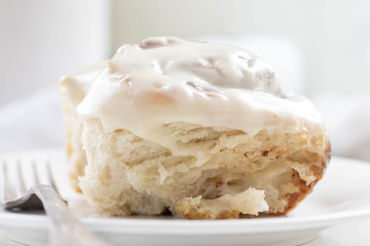 One Sourdough Cinnamon Roll on White Plate with Fork
