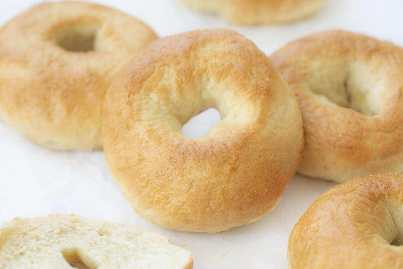 PLain Whole Bagel on Parchment with other plain bagels