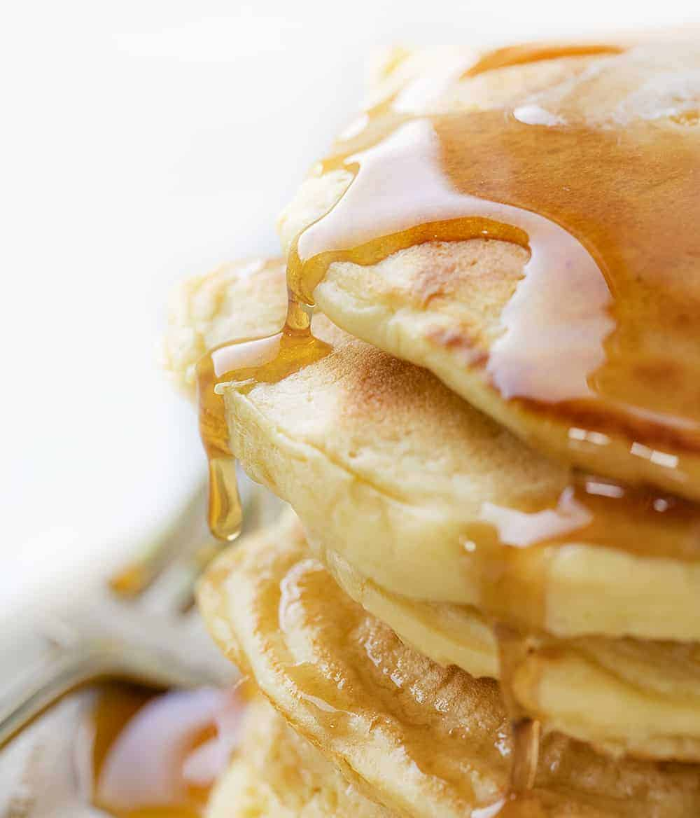 Close Up of Syrup Spilling over Stacked Sourdough Pancakes