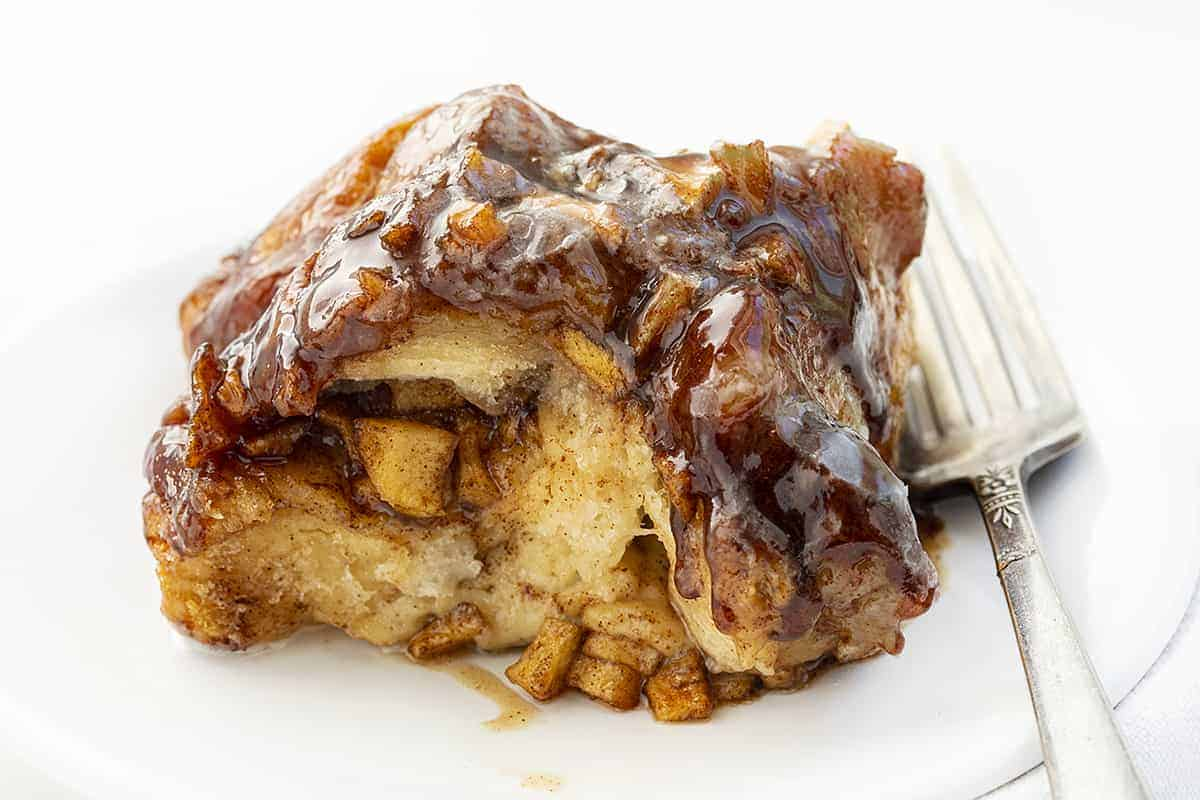 Piece of Apple Fritter Monkey Bread on Plate with Fork