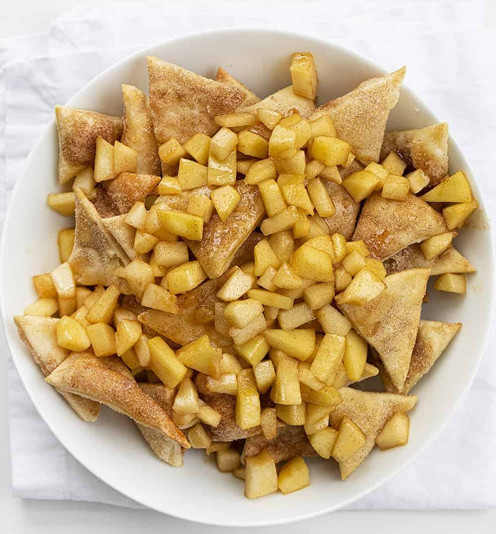 Overhead Image of White Bowl with Homemade Apple Pie Nachos in it on White Napkin