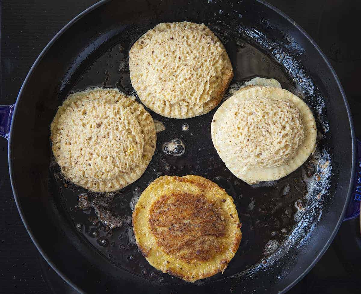 Frying Banana Bread French Toast Pockets in a Black Skillet
