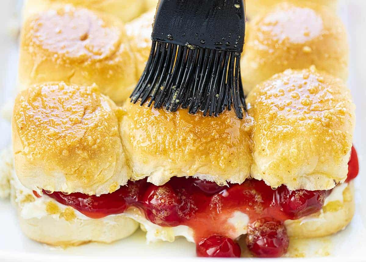 Spreading Topping Over Cherry Cheesecake Sliders