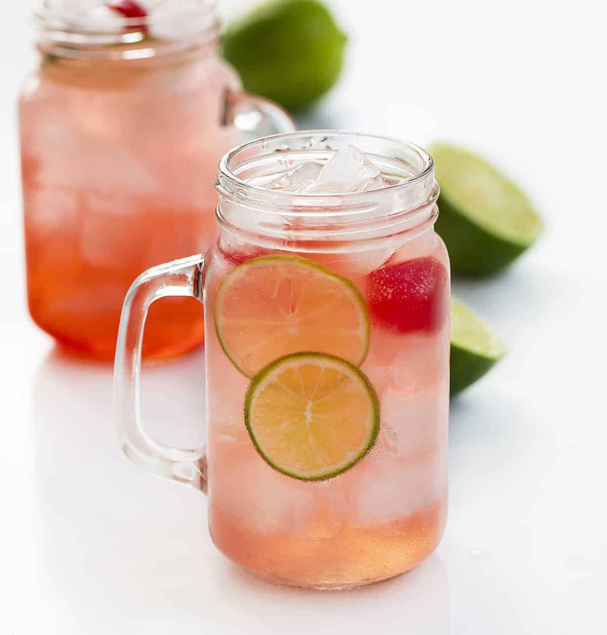 Two Glasses of Cherry Limeade Drink with Fresh Lime