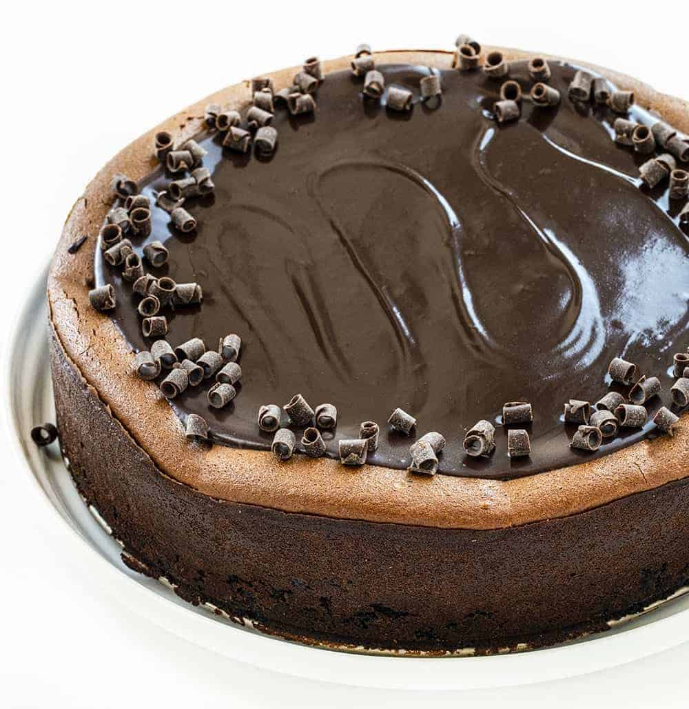 Triple Chocolate Cheesecake from Overhead Showing the Shiny Top and Chocolate Curls