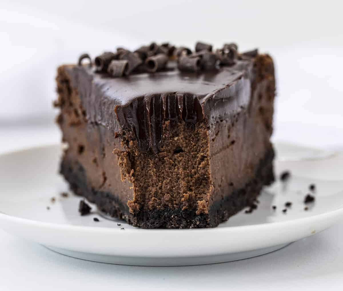 One Slice of Chocolate Cheesecake with the tip removed showing the inside