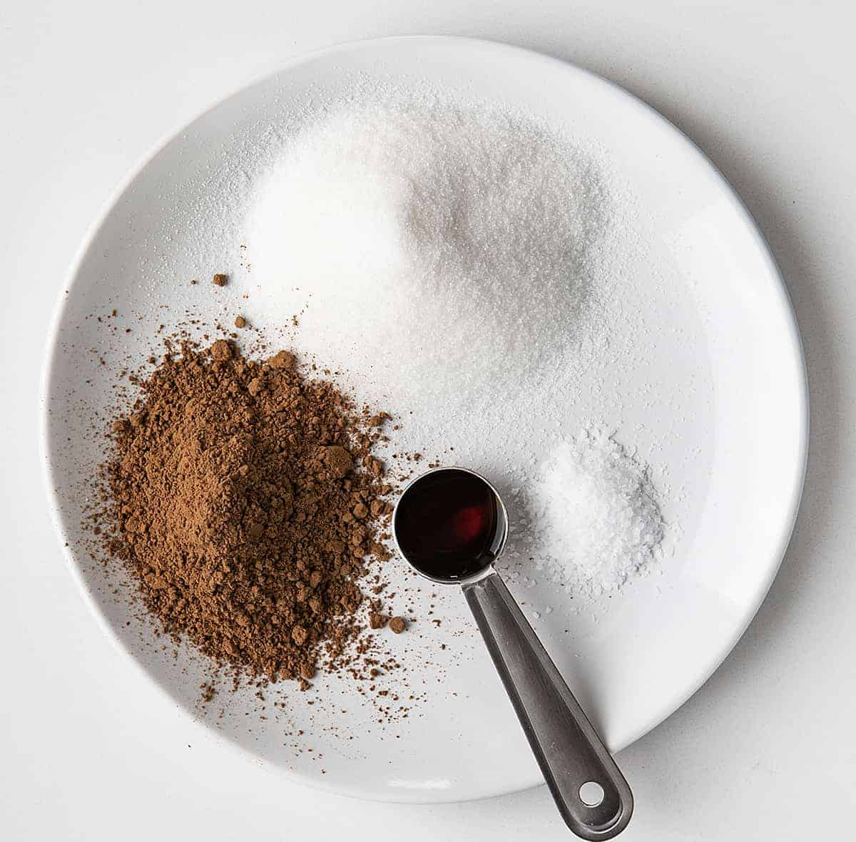 Raw Ingredients for Homemade Chocolate Fudge Sauce on White Plate