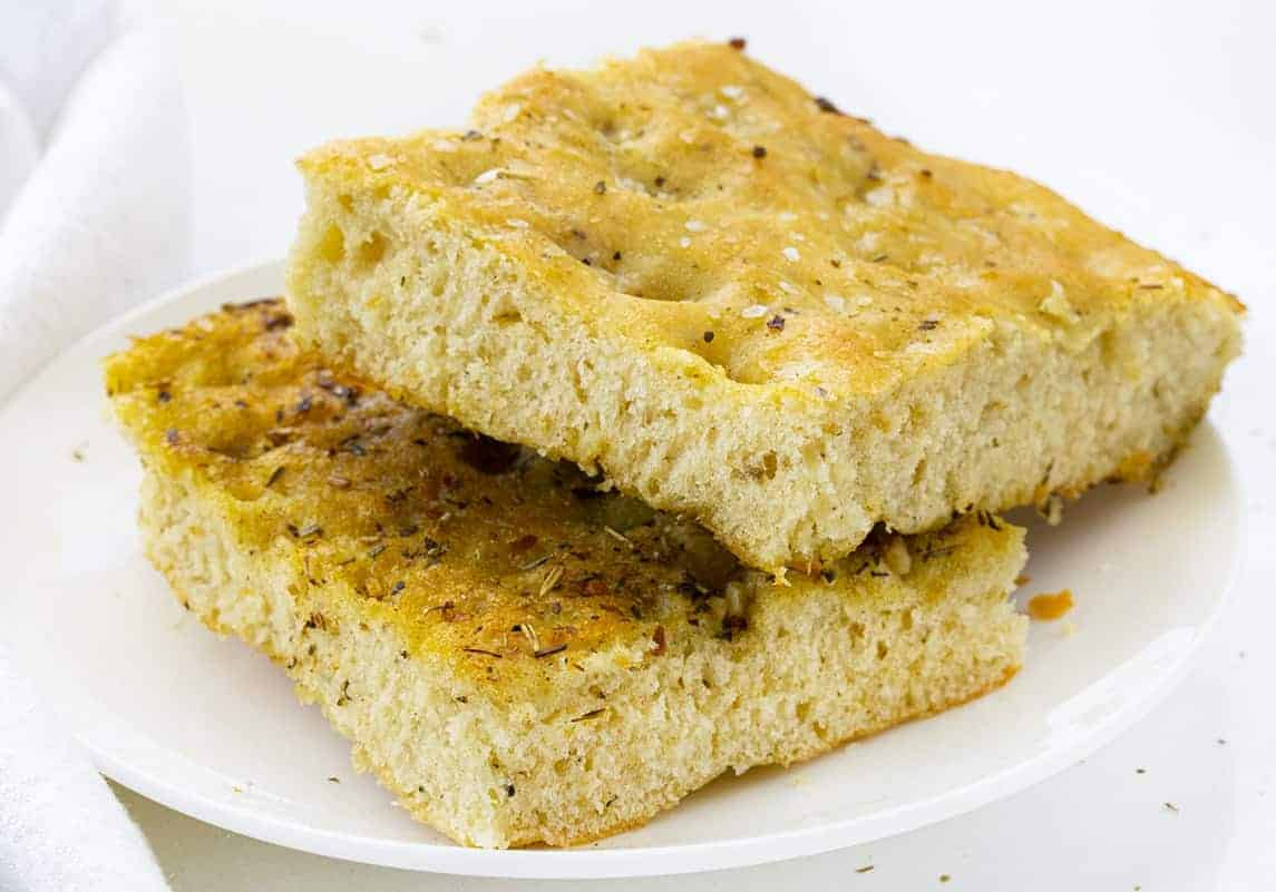 Easy Focaccia Bread Cut into Slices and on a White Plate