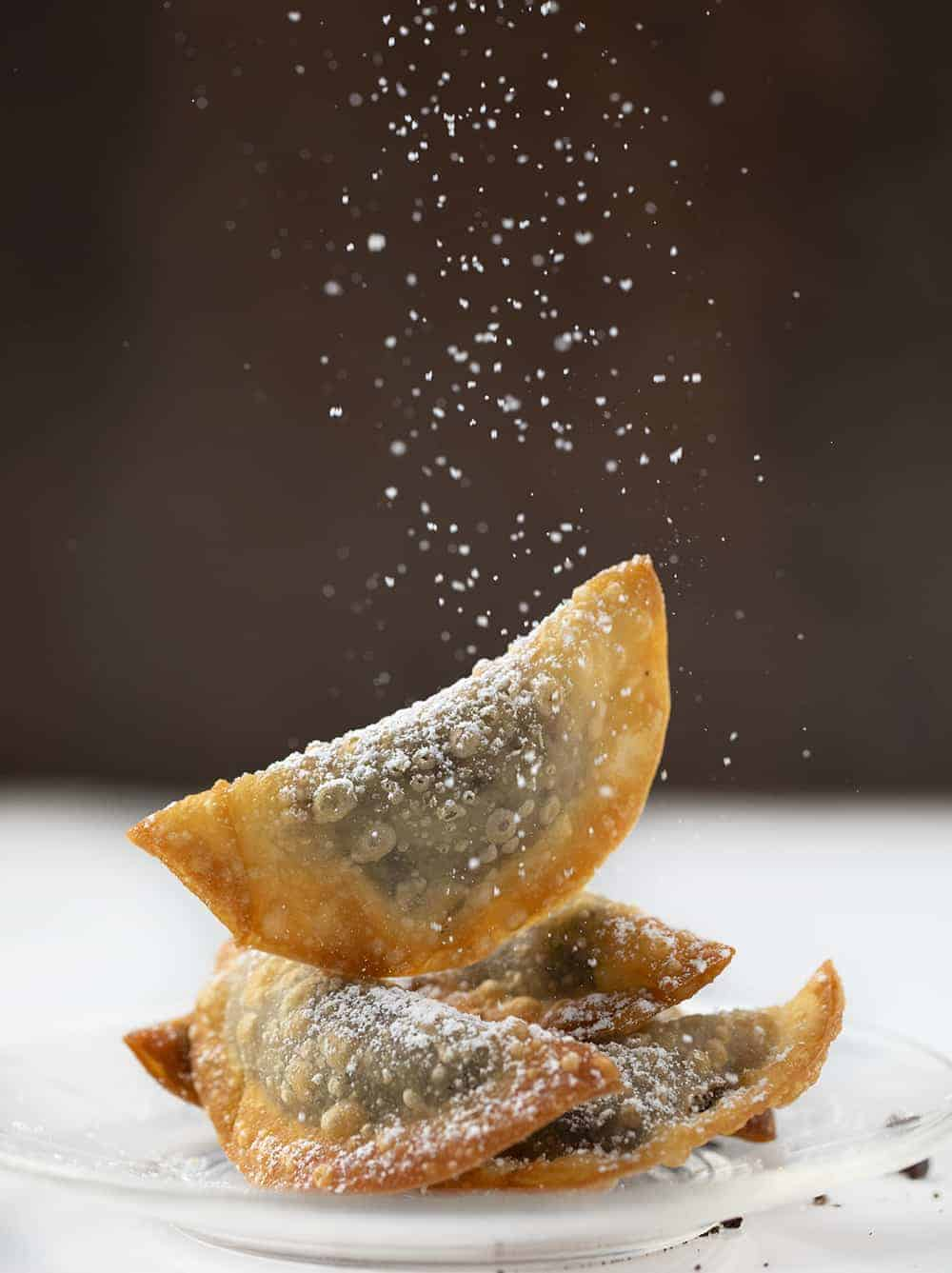 Sprinkling Confectioners Sugar over Deep Fried Oreo Wontons - Cookies and Cream Eggrolls
