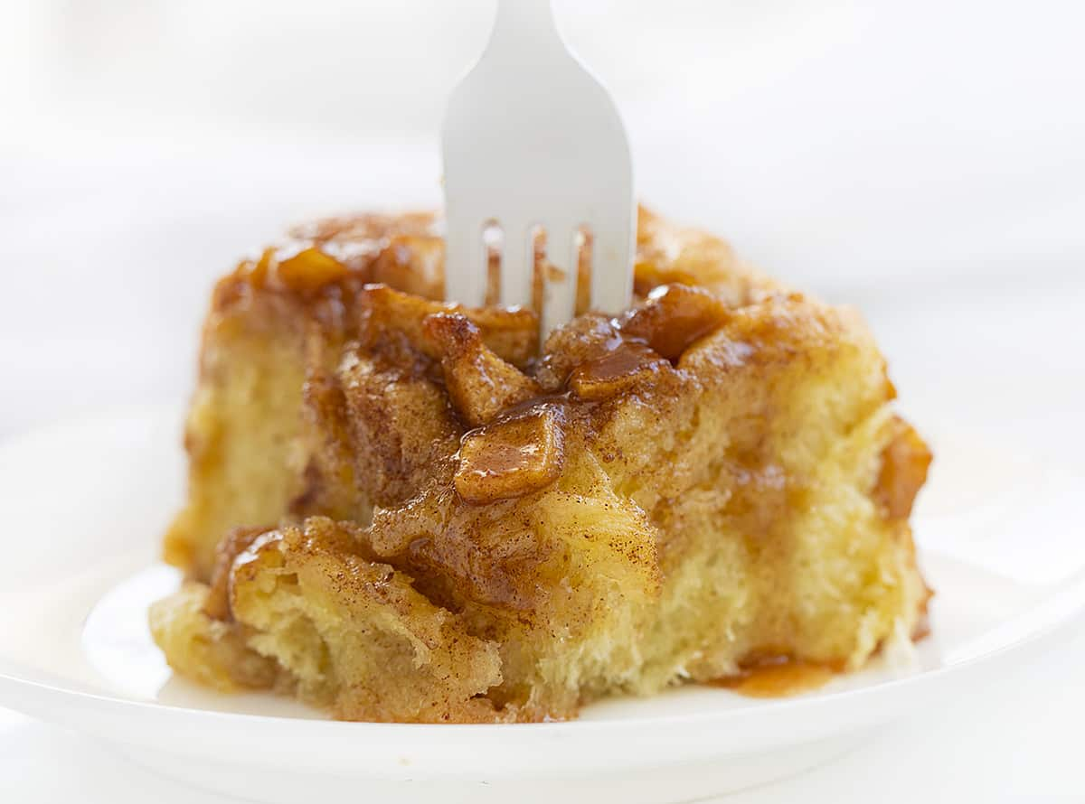Apple Roll on a Plate with Fork Sticking Out of the Top