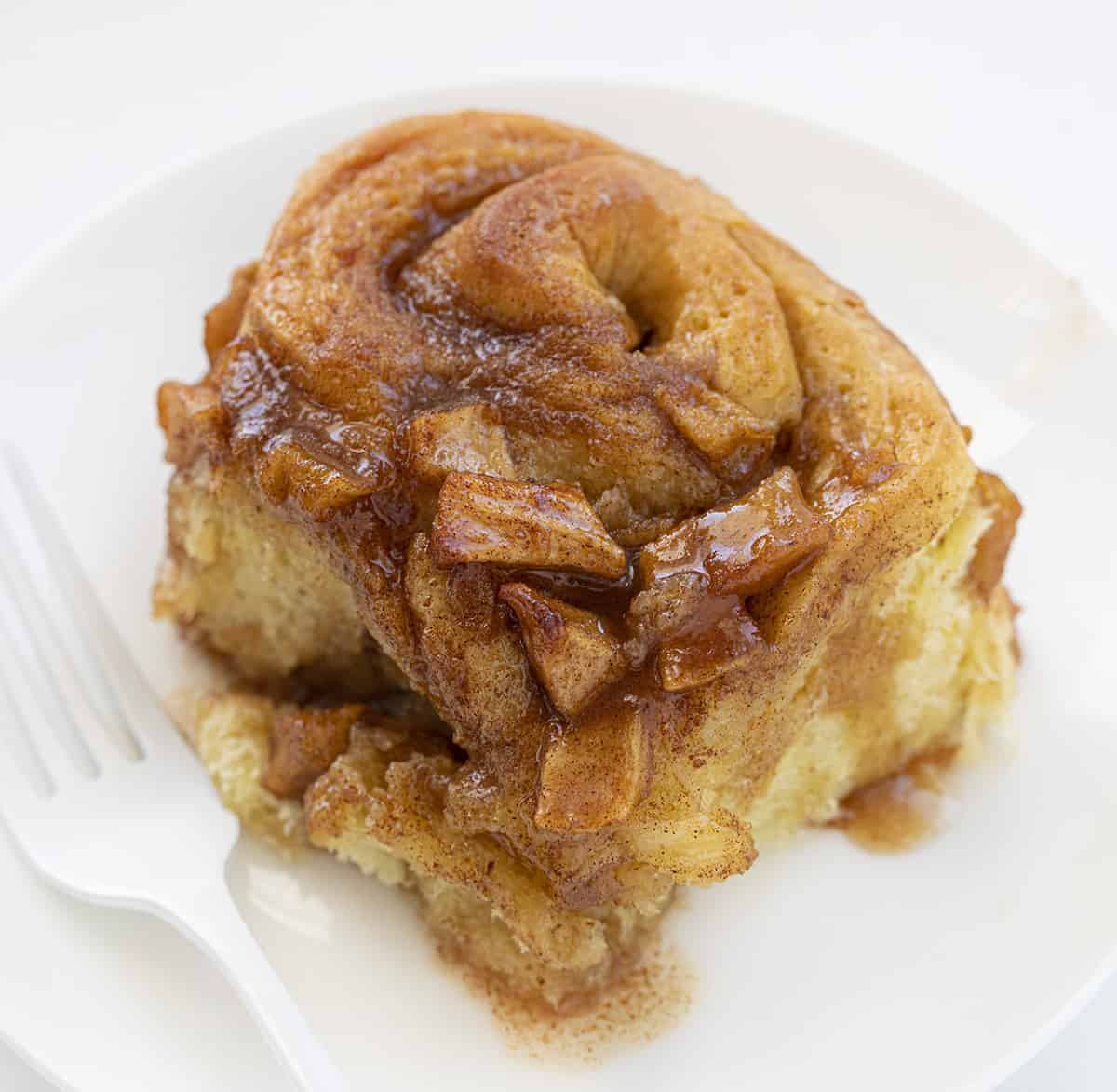 Apple Cinnamon Roll on White Plate with White Fork