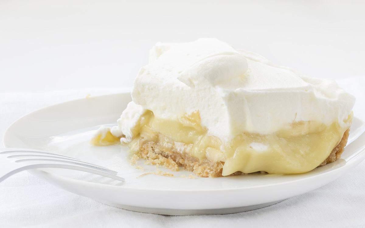 Slice of Half Eaten Banana Cream Pie with White Fork
