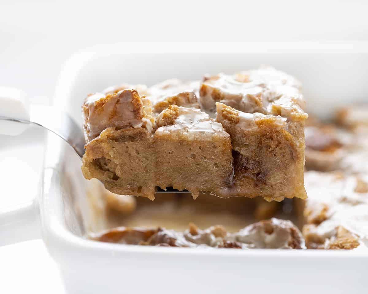 Spatula Holding Piece of Chocolate Caramel Bread Pudding Recipe