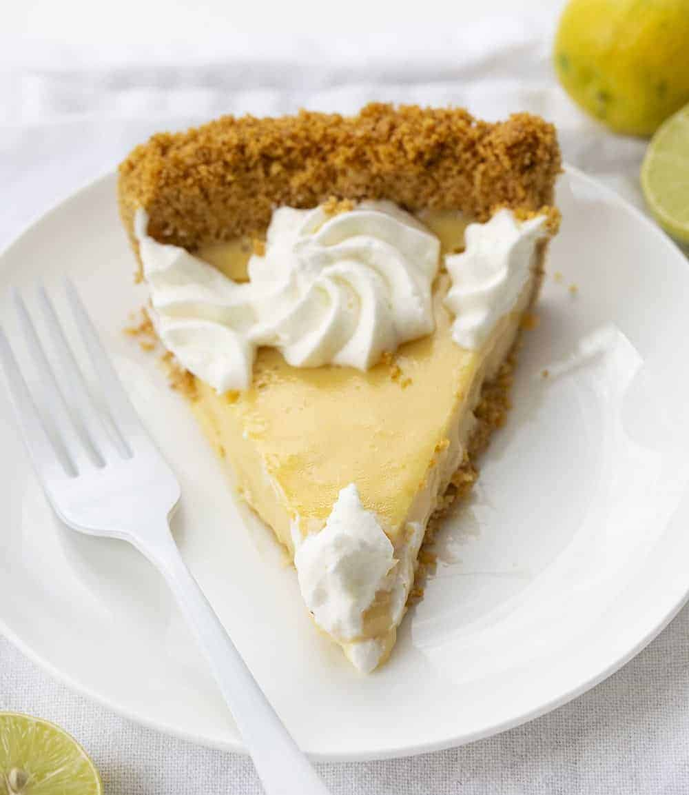 ONe Slice of Real Key Lime Pie on White Plate with White Fork