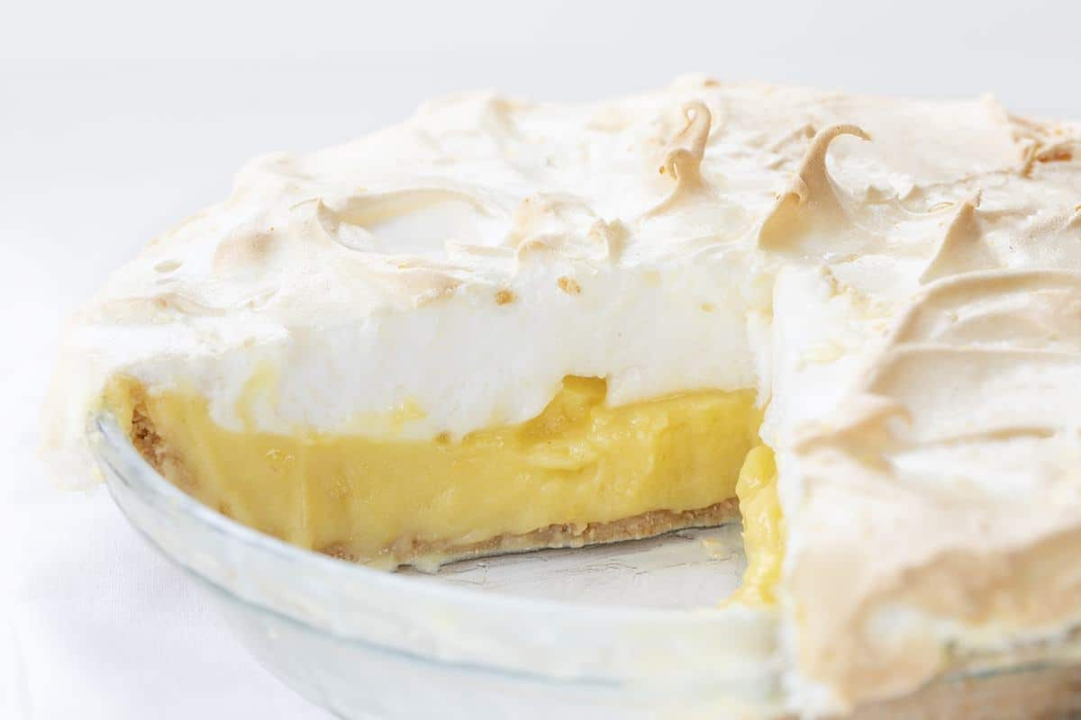 Lemon Meringue Pie with a couple of Pieces Removed Showing the Inside