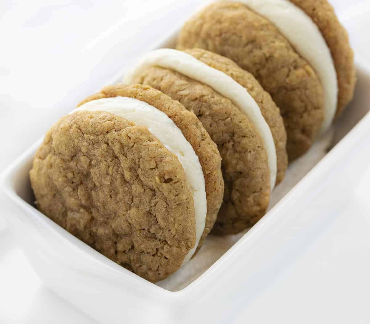 Oatmeal Cream Pie Cookies Stacked in White Ceramic Dish