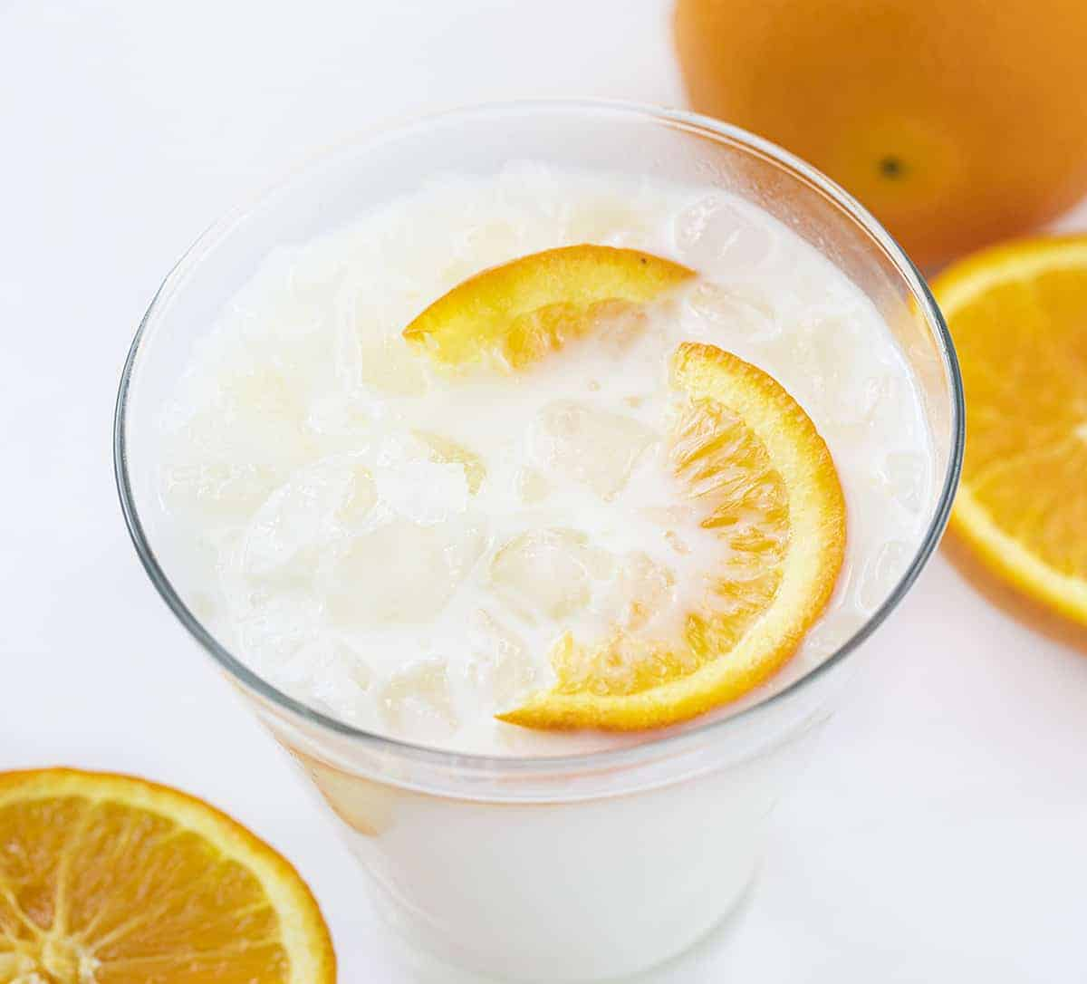 Iced Orange Creamsicle Drink with Orange Slices and Crushed Ice