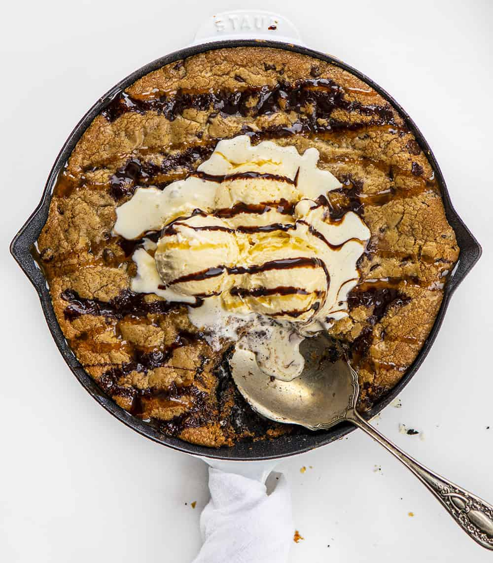 Overhead of Skillet Chocolate Chip Cookie with Ice Cream and Spoon