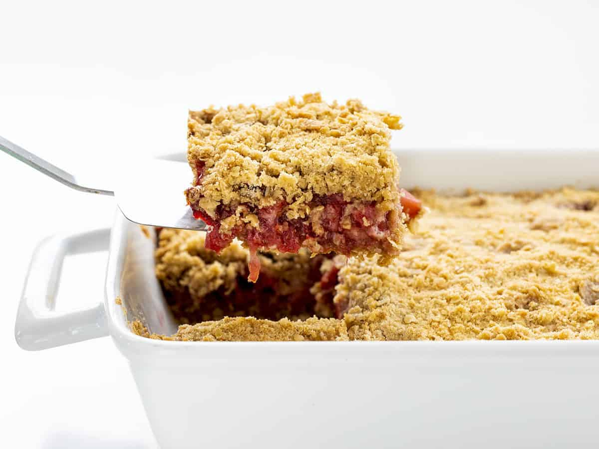 Spatula Holding up One Piece of Strawberry Crisp Being Removed from Pan
