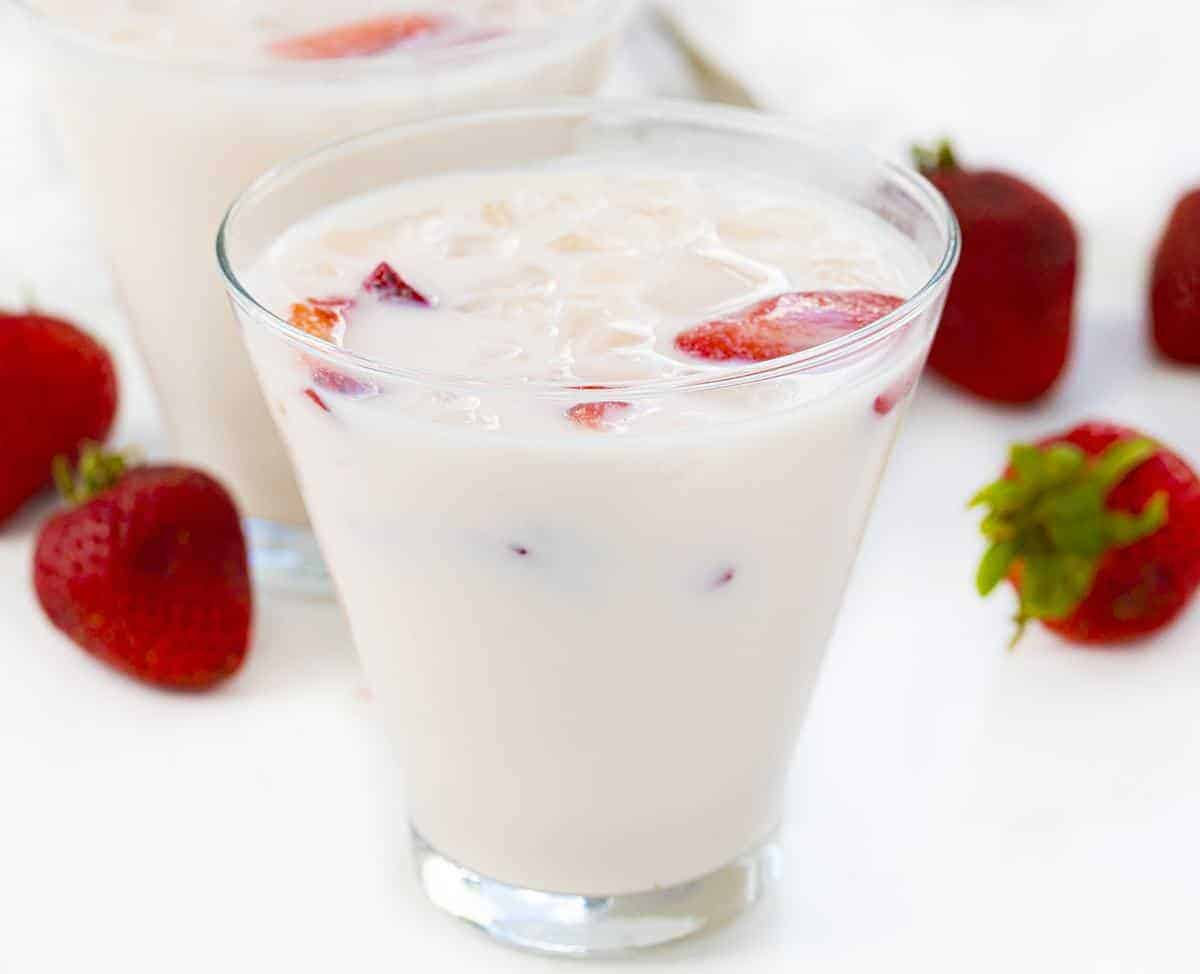 Glass of Strawberries and Cream Milk with Strawberries in Background