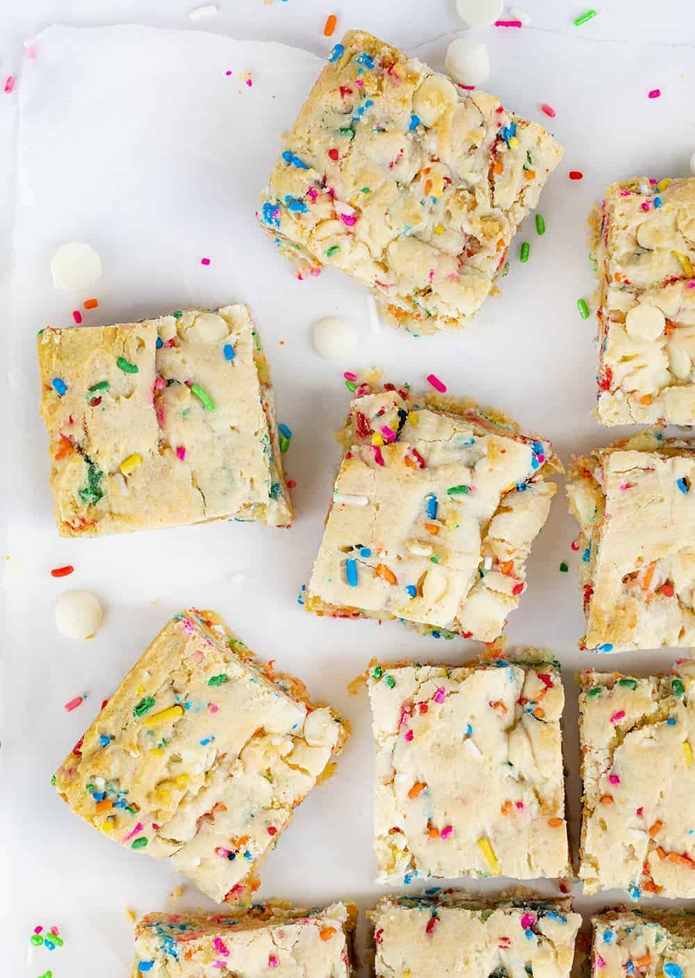OVerhead Image of Birthday Blondies Cut Into Pieces and Pulled Apart