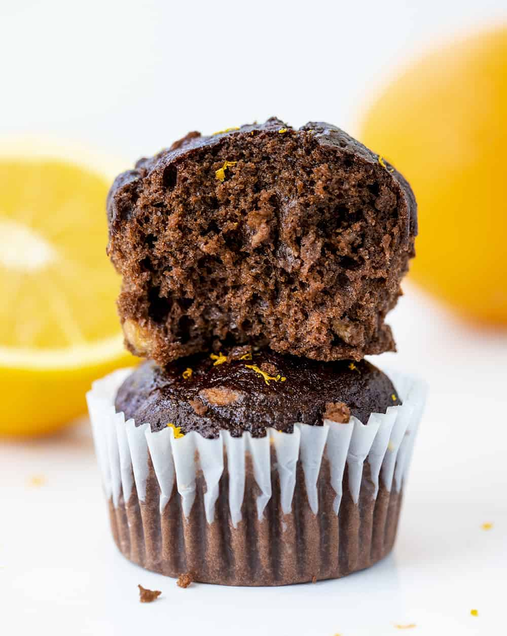 Stacked Chocolate Orange Muffins with One Cut in Half to Show the Inside