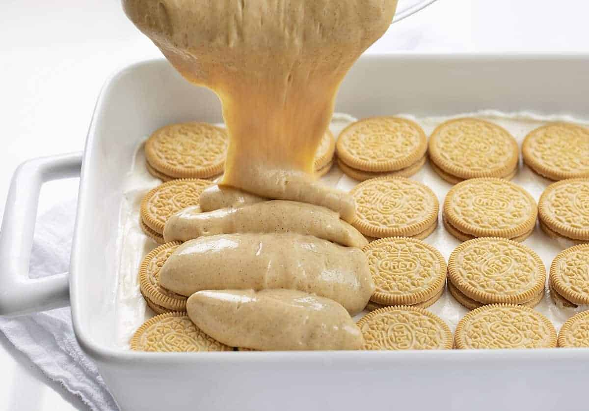 Pouring Cinnamon Vanilla Pudding Over Golden Oreos to Make Dessert