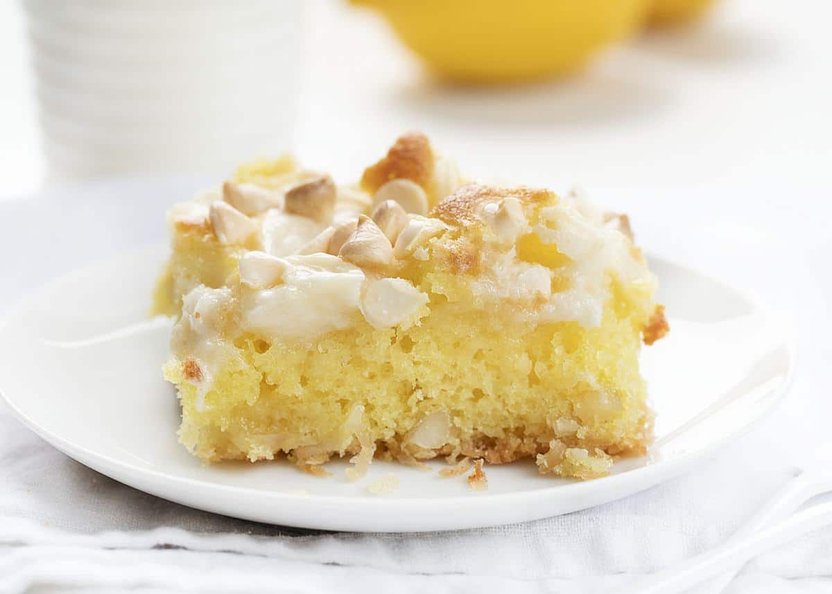 One Slice of Lemon Earthquake Cake on White Plate