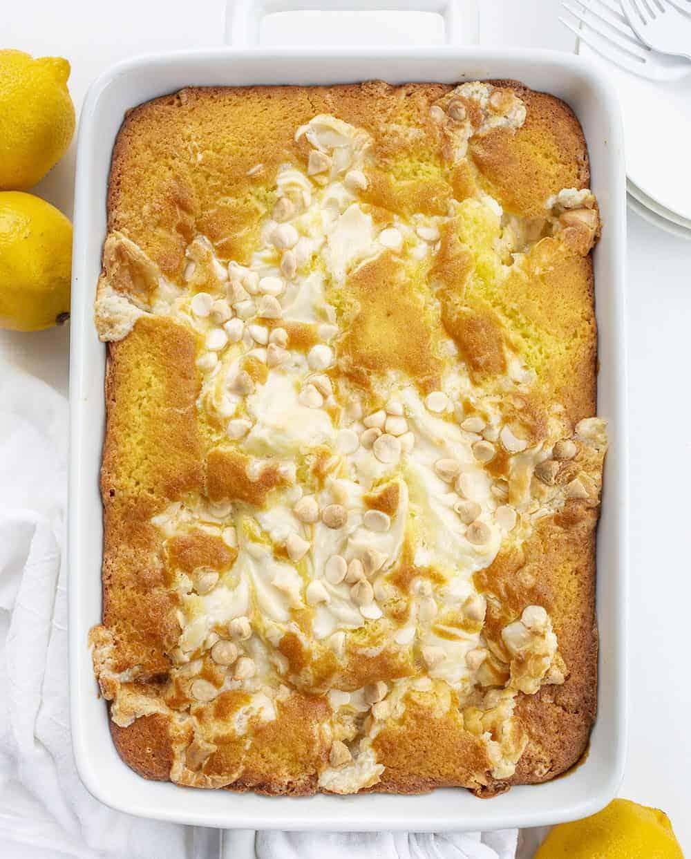 Overhead of Lemon Earthquake Cake in White Pan with Lemons