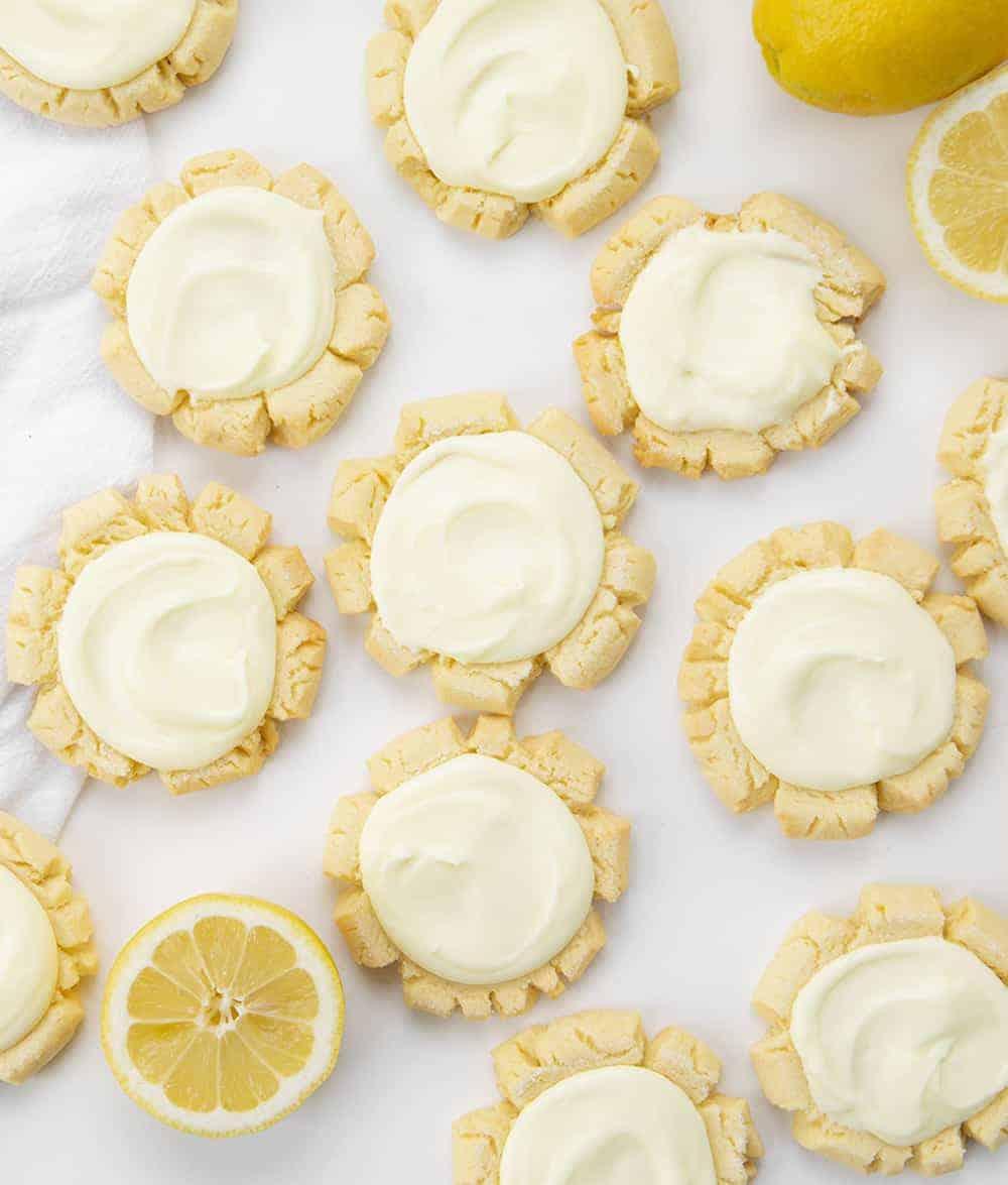 Overhead View of Lemon Sugar Cookies with Lemon Frosting and Lemons