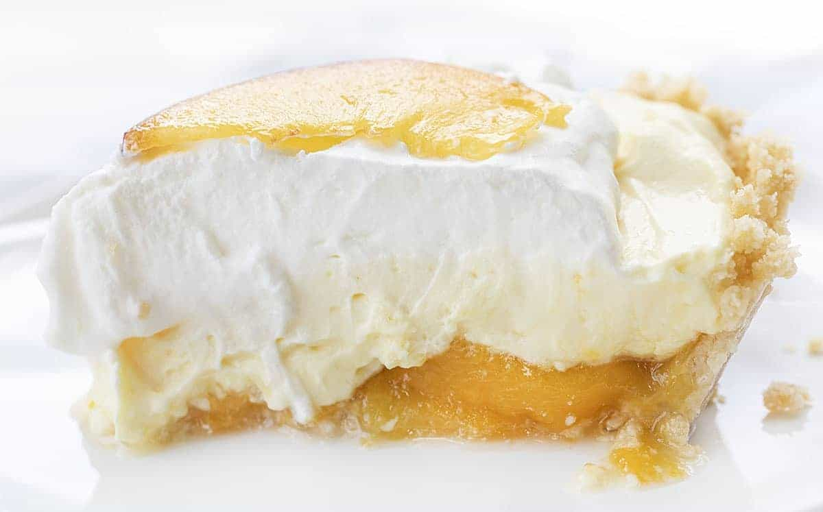 Side View of a Peaches and Cream Pie on White Plate