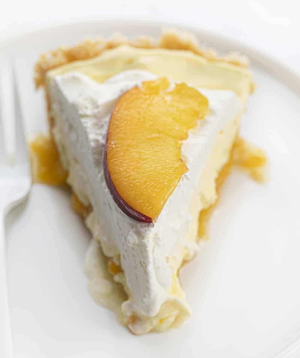 One Piece of Peaches and Cream Pie on White Plate with White Fork