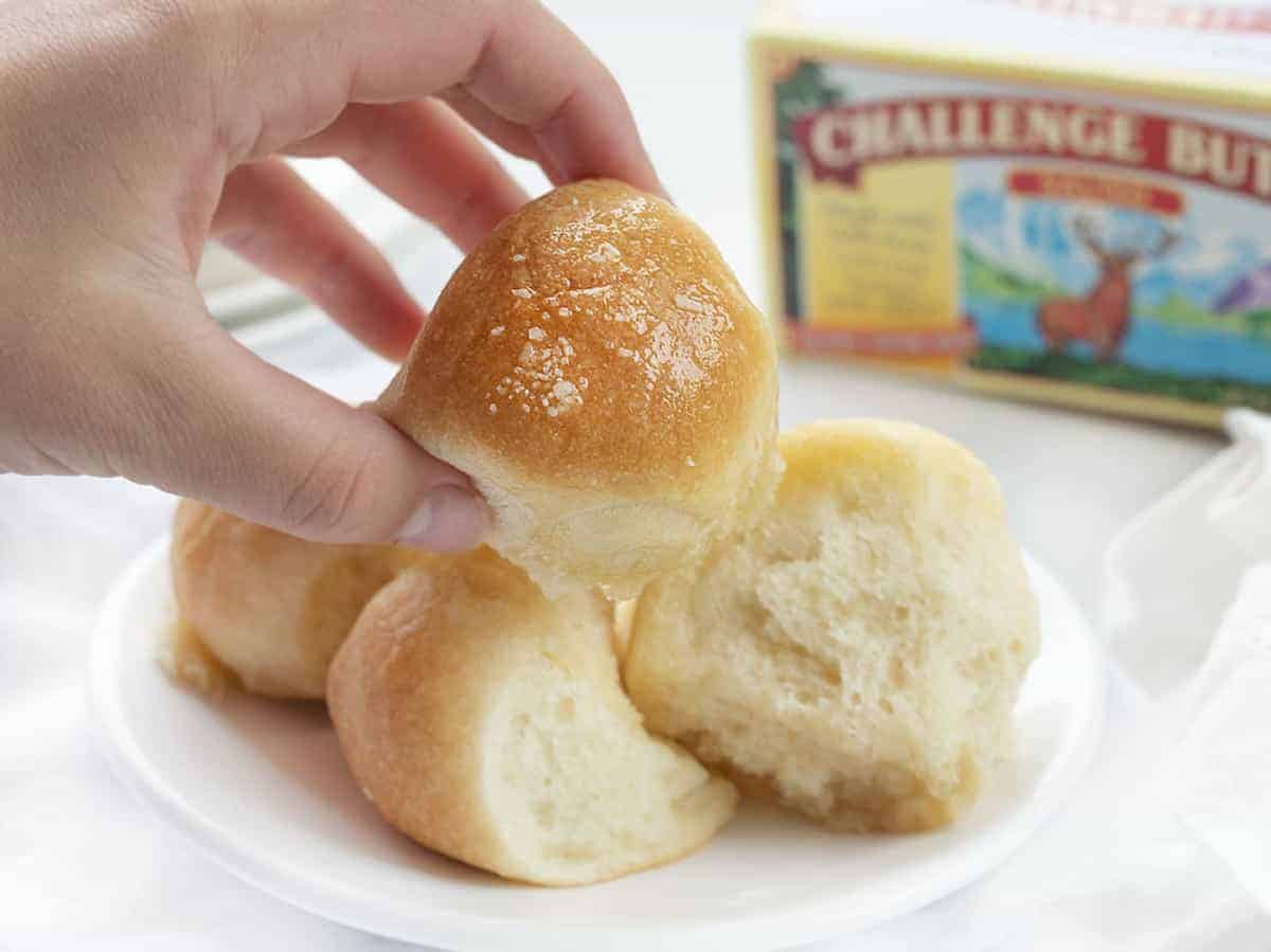 Hand Holding one Piece of Bubble Bread