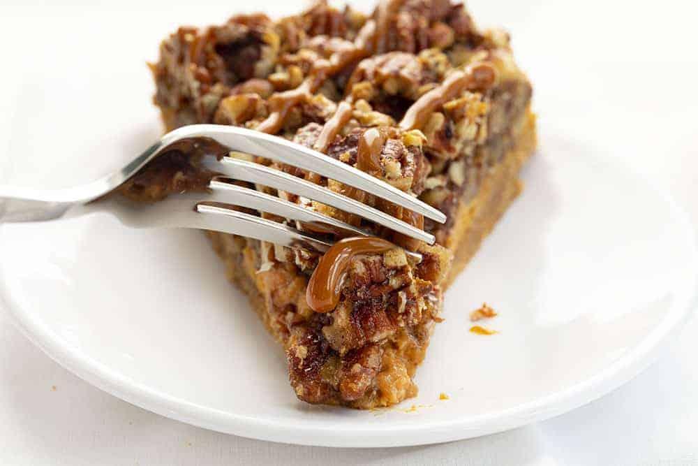 Fork Taking Bite of Dulce de Leche Pecan Pie